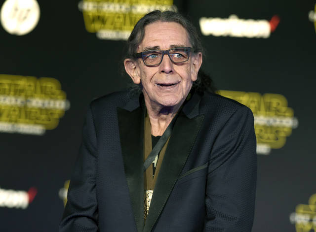 "Peter Mayhew arrives at the world premiere of ""Star Wars: The Force Awakens"" in 2015 in Los Angeles. Mayhew, who played the rugged, beloved and furry Wookiee Chewbacca in the ""Star Wars"" films, died at his home in north Texas on Tuesday, according to a family statement. He was 74."