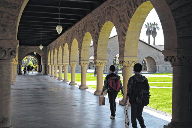 People walk on the Stanford University campus in Santa Clara, Calif., on March 14. Financial aid award letters are known to be tricky to understand due to jargon and a lack of clarity about how much you have to pay out of pocket. If you can't interpret your financial aid award, you won't be able to compare letters from different schools.