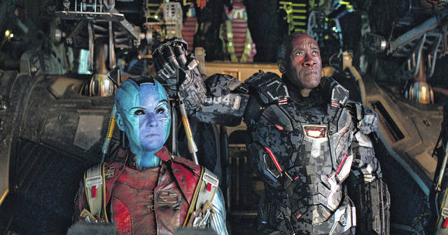 """This image released by Disney shows Karen Gillan, left, and Don Cheadle in a scene from """"Avengers: Endgame."""""""