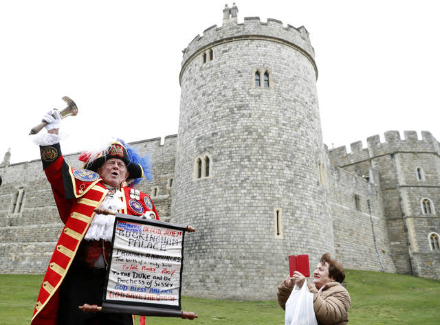 An unofficial Town Crier announces the birth of a baby boy born to Britain's Prince Harry and Meghan, the Duchess of Sussex, outside Windsor Castle in Windsor, south England, on Monday after Prince Harry announced that his wife Meghan, Duchess of Sussex, has given birth to a boy.