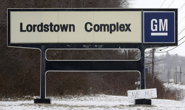 "FILE - In this March 6, 2019, file photo, a ""Save Me"" sign rests against the General Motors Lordstown Complex sign in Lordstown, Ohio. General Motors plans to sell its shuttered factory in Lordstown, to a company that builds electric trucks. President Donald Trump announced the deal Wednesday morning, May 8, 2019, on Twitter. (AP Photo/Tony Dejak, File)"