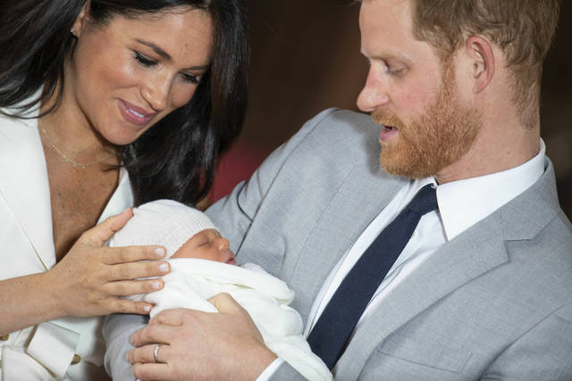 Britain's Prince Harry and Meghan, Duchess of Sussex, pose during a photocall with their newborn son, Archie Harrison Mountbatten-Windsor, in St. George's Hall at Windsor Castle, Windsor, south England, on Wednesday.