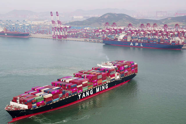 A container ship sails off the dockyard in Qingdao in eastern China's Shandong province Wednesday. China's exports fell unexpectedly in April, adding to pressure on Beijing ahead of negotiations on ending a tariff war with Washington over Chinese technology ambitions.
