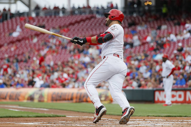 Cincinnati Reds' Eugenio Suarez hits an RBI double off Chicago Cubs starting pitcher Yu Darvish in the first inning of a baseball game, Wednesday in Cincinnati.
