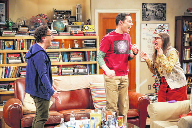"""This photo provided by CBS shows, from left, Johnny Galecki, Jim Parsons and Mayim Bialik in a scene from the series finale of """"The Big Bang Theory."""""""