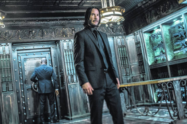 "Keanu Reeves appears in a scene from ""John Wick: Chapter 3 - Parabellum."" The third installment of the hyper violent Keanu Reeves franchise has taken the top spot at the North American box office and ending the three-week reign of ""Avengers: Endgame."" Studios on Sunday say ""John Wick: Chapter 3 - Parabellum"" grossed an estimated $57 million in its opening weekend."