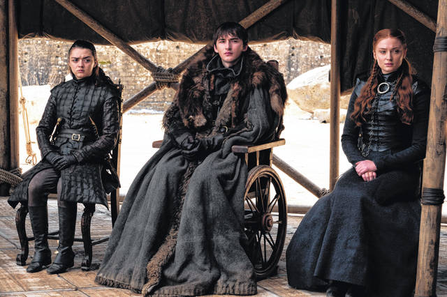 "This image released by HBO shows, from left, Maisie Williams, Isaac Hempstead Wright and Sophie Turner in a scene from the final episode of ""Game of Thrones,"" which aired Sunday."