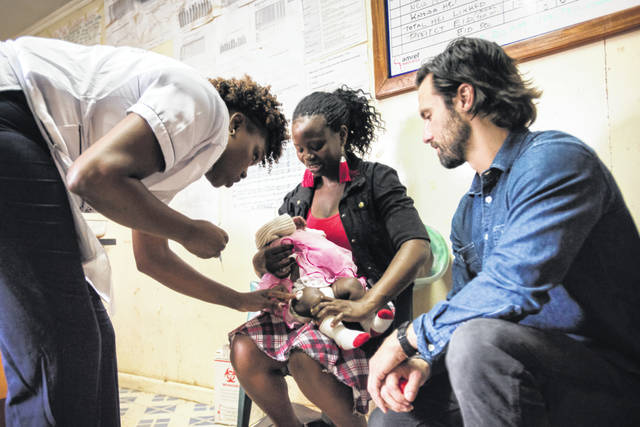 """Actor Milo Ventimiglia visits the vaccination clinic at Kibera AMREF Health Centre in Nairobi, Kenya. Ventimiglia, star of the series """"This Is Us,"""" traveled to Kenya and saw programs supported by the campaign providing health care, education and more. Video of his trip is included in NBC's two-hour Red Nose Day special airing Thursday with host Terry Crews."""