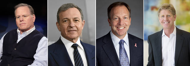 This photo combination shows four of the highest-paid CEOs at big U.S. companies for 2018, as calculated by The Associated Press and Equilar, an executive data firm. From left: David Zaslav, Discovery, $129.5 million; Robert Iger, Walt Disney, $65.6 million; Stephen MacMillan, Hologic, $42 million; and Joseph Hogan, Align Technology, $41.8 million. The third-highest paid CEO, Richard Handler of Jefferies Financial Group, is not pictured. Handler made $44.7 million. (AP Photo)