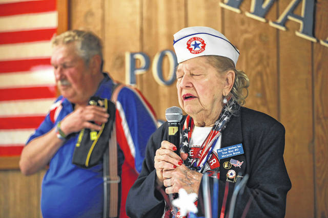 Marjoree Bryan gives the invocation during the Memorial Day wreath laying service at the VFW hall in Lima.