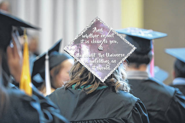 Graduates listen to Riordan McClain giving the commencement speech during the 119th annual Baccalaureate Commencement ceremony held at Bluffton University's Sommer Center on Sunday afternoon.