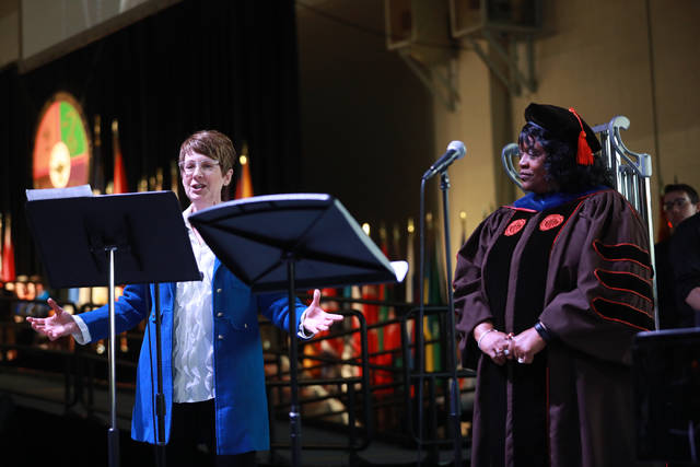 Professor Kirsten Osbun-Manly (left) and Dr. Adriane L. Thompson-Bradshaw perform with the symphonic band during the Commencement at Ohio Northern University on Sunday afternoon. Amanda Wilson -The Lima News