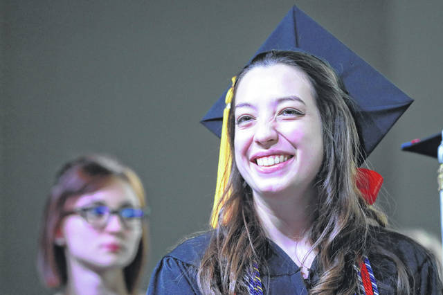 Clara Huffman is all smiles after performing with the symphonic band during the 148th Commencement at Ohio Northern University on Sunday afternoon in Ada. Amanda Wilson | The Lima News