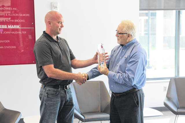 Ron Kaufman, facilities superintendent for Ohio State-Lima and Rhodes State College, received the Energy Efficiency Champion Award from Gary Hendrickson, Continuous Energy Improvement coach from AEP Ohio.