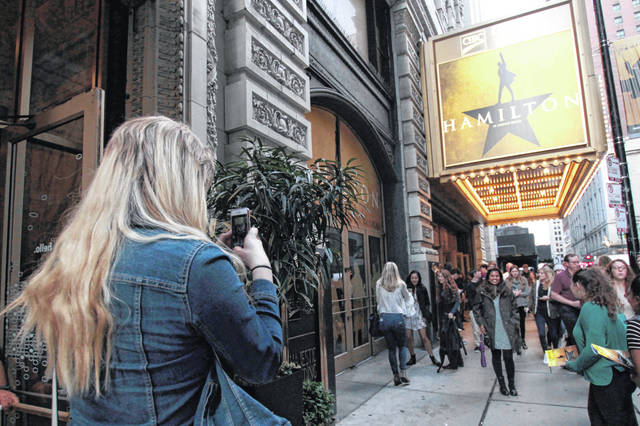 """Alex Richards takes a photo in October 2017 of Meera Ganesh outside the CIBC Theatre after watching """"Hamilton: An American Musical"""" in Chicago. The musical """"Hamilton"""" will end its more than three-year run in Chicago in January. Producers made the announcement the production playing at downtown Chicago's CIBC Theatre would close Jan. 5, 2020."""