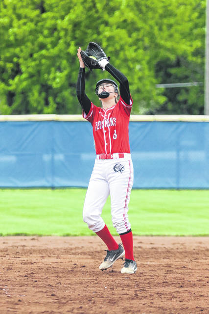 Wapakoneta's Corrin Wilder brings in a flyball during Friday night's Division II sectional final at Bath.