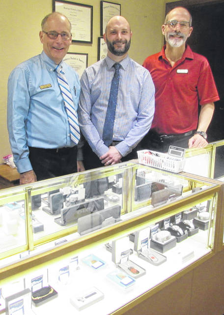 Beckman Jewelers in Ottawa will hand down to the next generation. From left are Beckman Jewelers current owner Stan Beckman; Stan's son Greg, who will serve as the new owner; and Barney Beckman, current owner.