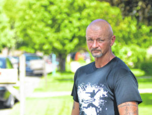Resident stands guard over alleged drug house