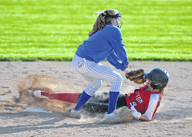 Bluffton's Averey Rumer slides safely under the tag of Allen East's Emma Moritz during Wednesday's game at Bluffton Village Sports Complex.