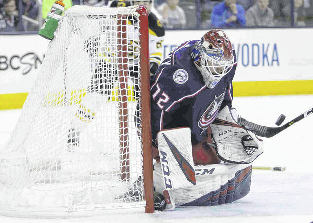 Columbus Blue Jackets' Sergei Bobrovsky, of Russia, makes a save against the Boston Bruins during the third period of Game 3 of an NHL hockey second-round playoff series Tuesday, April 30, 2019, in Columbus, Ohio. The Blue Jackets beat the Bruins 2-1. (AP Photo/Jay LaPrete)