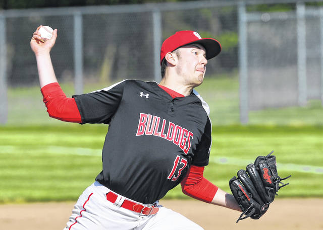 Columbus Grove's Nick Woods pitches during Tuesday night's home Putnam County League game against Kalida.