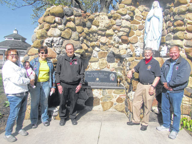 Immaculate Conception Catholic Church in Ottoville unveiled a pro-life memorial on Mother's Day. Pictures are, from left, Diane Bendele holding her great-niece Bailey Bible, Anne Hamker, the Rev. Jerry Schetter and Knights of Columbus members Jerry Hohlbein and Dan Honigford.