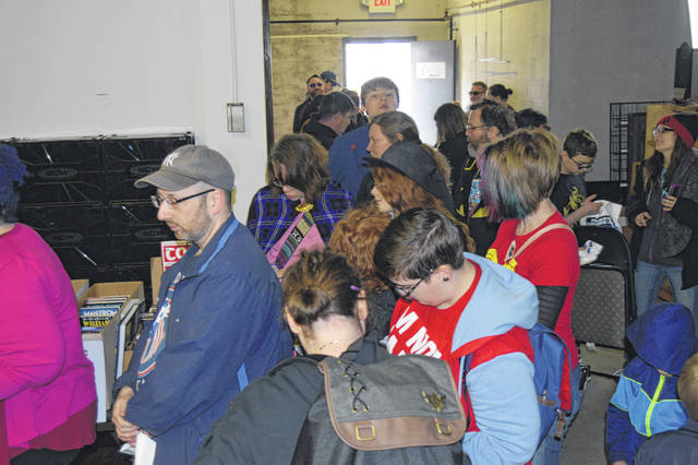 Hundreds of people waited in line to get free comic books Saturday at Alter Ego Comics in Lima.