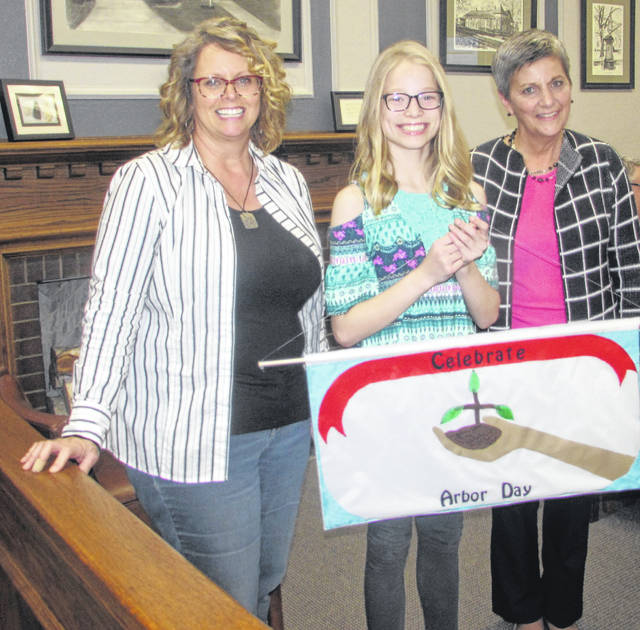 From left are Stephanie Miller, Ohio Department of Natural Resources certified urban forester, Greta Liebrecht, Arbor Day poster contest winner, and Jo Deskins, Ottawa council member and Shade Tree Commission member.