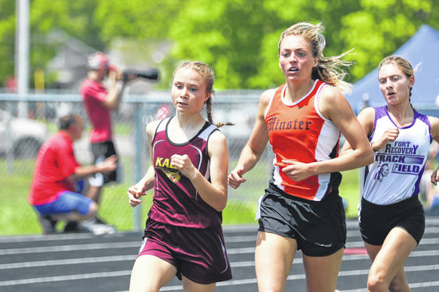 From left, Kalida's Kenzie Fortman, Minster's Kaitlynn Albers and Fort Recovery's Chloe Will compete in the 1,600-meter run during Saturday's Division III track and field district at Spencerville. Albers finished first followed by Fortman and Will.