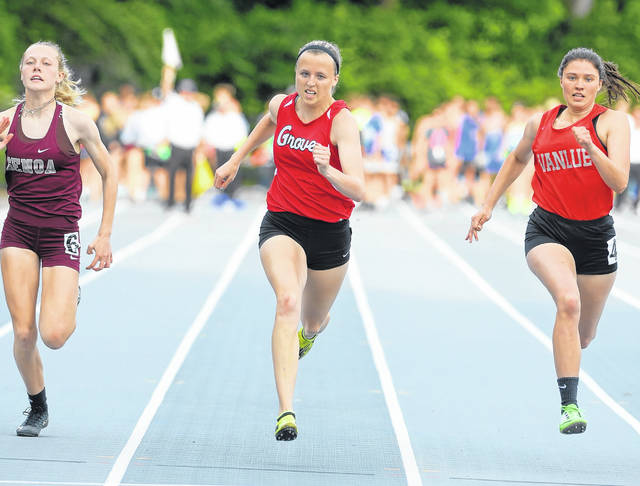 Columbus Grove's Rylee Sybert, center, competes in the 100-meter dash against Genoa's Rylee Fredericksen, left, and Vanlue's Bethany Smith during Friday's Division III regional at Heidelberg University's Hoernemann Stadium in Tiffin.