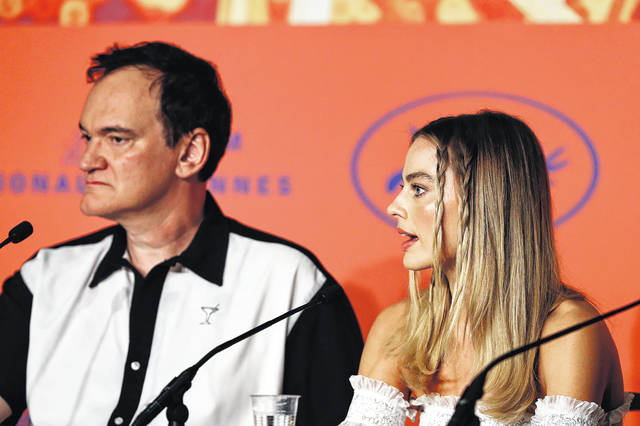 """Director Quentin Tarantino and Margot Robbie attend the """"Once Upon A Time … In Hollywood"""" Press Conference during the 72nd annual Cannes Film Festival on May 22, 2019 in Cannes, France."""
