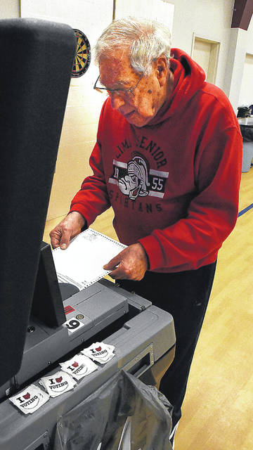 Bill Stein, of Lima, marks his ballot while voting at Senior Citizens Services on Elm Street on Tuesday morning.