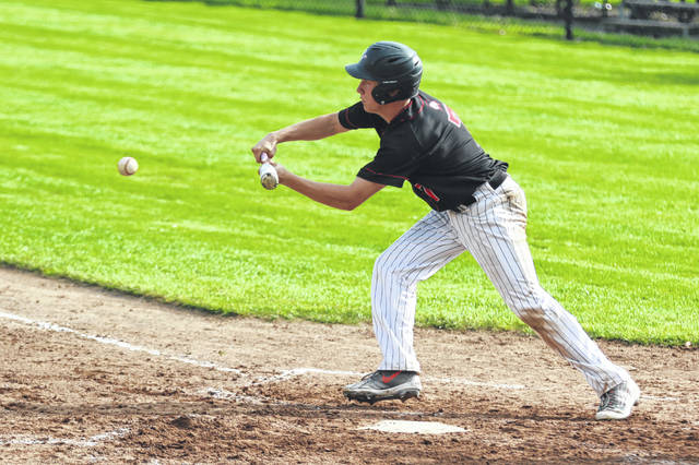 Shawnee's A.J. Brown of Shawnee puts down a bunt during Friday night's Division II sectional final at Elida's Ed Sandy Field.