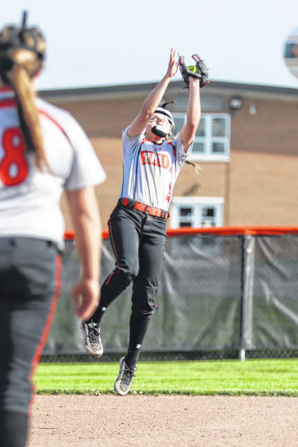 Elida's Lacie Moening goes up to secure the catch during Tuesday's Division II tournament home game against Van Wert.