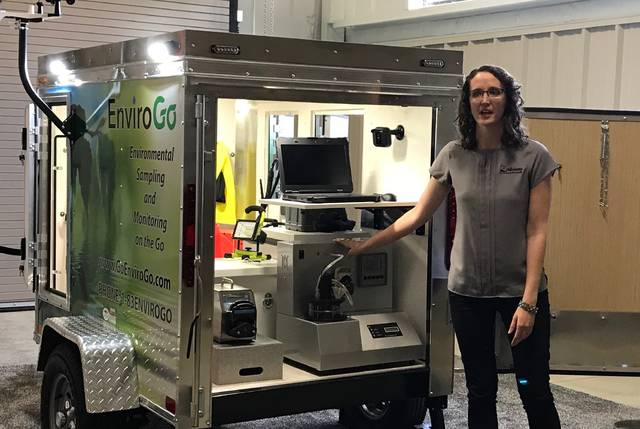 Alloway Marketing Director Jessica Begonia unveils a prototype for a line of mobile testing units, which will be sold under the company's new EnviroGo brand.