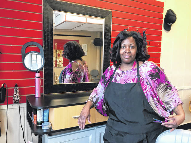 Essie Falls stands at her booth in PreciSion Falls Hair Care, which opened April 23. Mackenzi Klemann | Lima News.