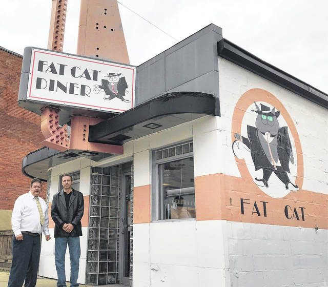 Todd Sterling (left) and Matthew Treadway stand in front of the old Fat Cat Diner on North Main Street. The two plan to reopen the diner this summer as an American and Southern-style restaurant, rebranded as Teasers Diner.