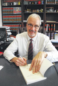 Beyond the robe: Lima judge shows off writing skills with release of new book