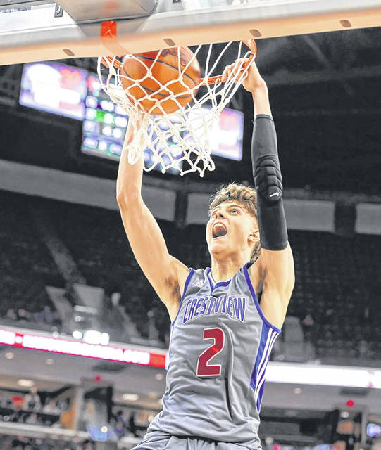 Crestview's Kalen Etzler dunks for two points during the Knights' win over Berlin Hiland in the Division IV boys basketball state championship.