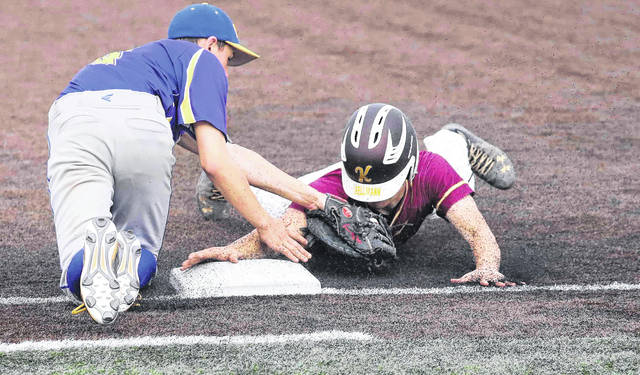 Miller City's Tyler Long tags out Kalida's Clay Bellmann during Friday's Division IV district final at Defiance High School.