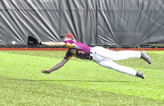 Kalida's Zach von der Embse dives but is unable to make a catch on a fly ball against Arlington during Wednesday's Division IV district semifinal game in Defiance.