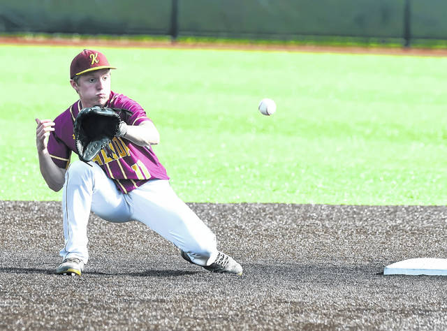 Kalida's Matt Kehres attempt to tag Arlington's Frankie Jones (not shown) during Wednesday's Division IV district semifinal game in Defiance.