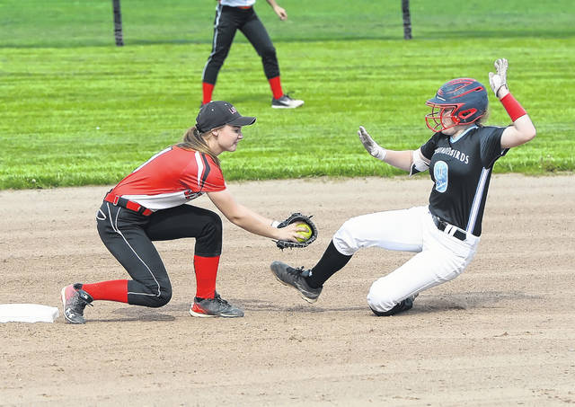 Delphos Jefferson's Anna Fitch tags Lima Central Catholic's Jaylen Rhoem during Monday's Division IV sectional tournament at Faurot Park.