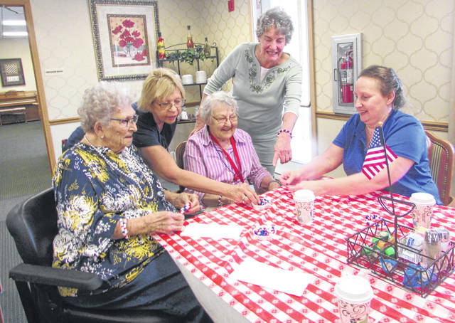 From left are Mary Balbaugh, The Meadows of Leipsic resident, Nancy Gerding, Balbaugh's daughter, Shirley Russell, Meadows resident, Karen Doll, volunteer and Julie Binkley, resident care associate.