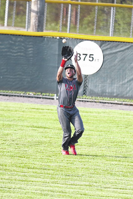 Lima Seniors Brayden O'Dell fields a fly ball to center field to capture an out against Perrysburg on Wednesday evening during the Division I District Semifinals at Bowling Green.