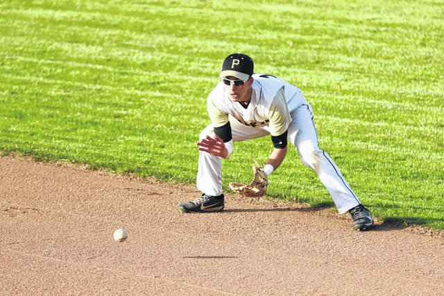 Daniel Krueger of Perrysburg fields a ground ball and captures the out at first against Lima Senior on Wednesday evening during the Division I District Semifinals at Bowling Green.    Levi A. Morman | The Lima News