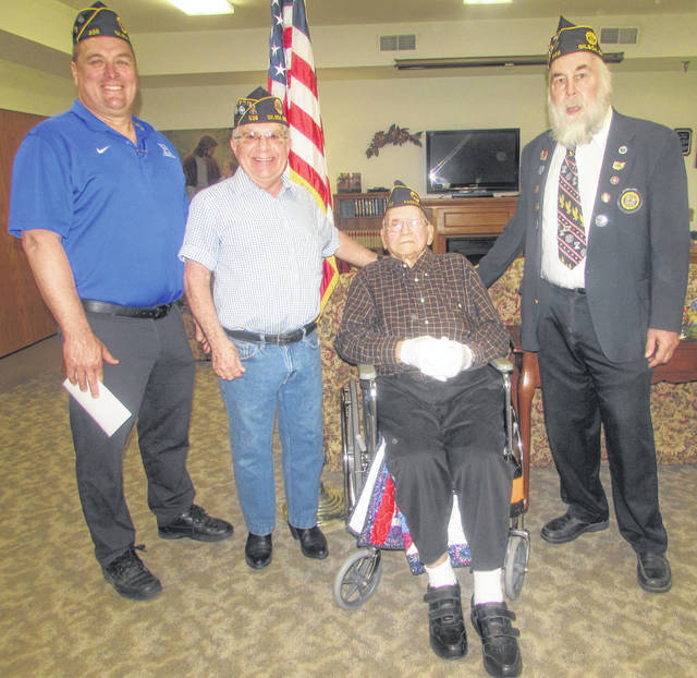 From left, Paul Burkholder, American Legion Harter Williams Post 536 Gilboa member, Lennis Core, post Sergeant of Arms, Louis Risser, 70-year legion member, and Roy Sutter, post commander, celebrate Risser's service to the American Legion.