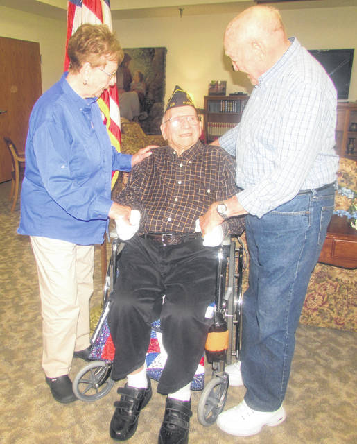 From left, Ruby Basinger, Pandora resident greets friend Louis Risser, a 70-year American Legion Harter Williams Post 536 Gilboa member, along with Basinger's husband, Don.