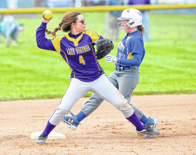 Leipsic's Kacey Dulle gets the force out against Miller City's Nicole Ellerbrock during Saturday's game at Miller City.