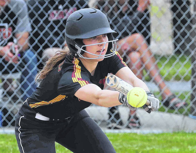 New Bremen's Taylor Paul attempts a bunt during Thursday night's Division IV district final against Minster at Wapakoneta.